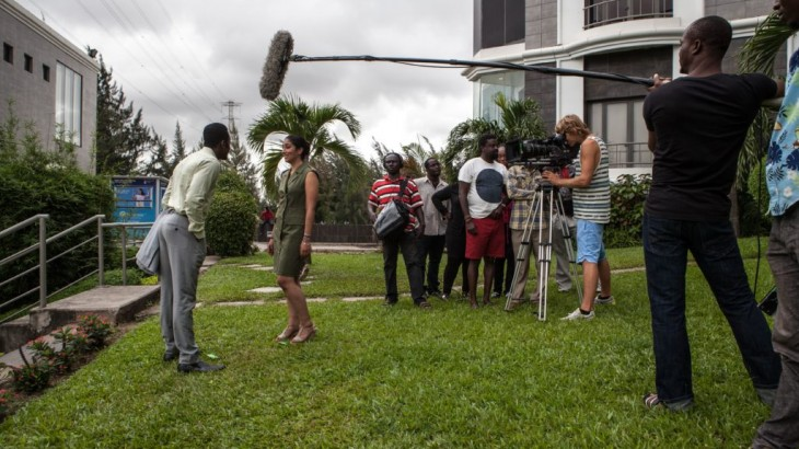 "TO GO WITH AFP STORY BY FLORIAN PLAUCHEUR Nigerian actor Wole Ojo and Moroccan actress Fatym Layachi play during the shooting of the movie ""The CEO"" on September 14, 2015 in Lagos. With a budget of more than USD 1 million (880,000 euros) and with a pan African casting, ""The CEO"" is a far cry from the shoestring productions that characterise the bulk of Nollywood's output. AFP PHOTO / FLORIAN PLAUCHEUR        (Photo credit should read FLORIAN PLAUCHEUR/AFP/Getty Images)"